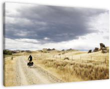 Cyclist on the Otago Central Rail Trail wanddecoratie. During my own cycle tour through New Zealand I met up with another cyclist at the start of the Central Otago Rail Trail. It feels like you're in the American Wild West while on the trail, only thing missing are some cowboys.